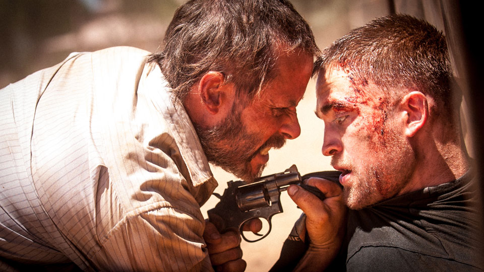 Eric (Guy Pearce), Rey (Robert Pattinson)